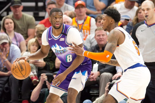 Jan 8, 2020; Salt Lake City, Utah, USA; Utah Jazz guard Emmanuel Mudiay (8) dribbles the ball as New York Knicks guard Elfrid Payton (6) defends during the first half at Vivint Smart Home Arena.