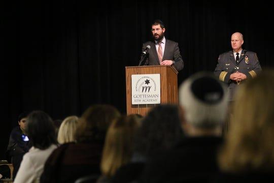 Rabbi Levi Dubinsky speaks at the Morris County Community Rally Against Hate, in Randolph, near Morris County Sheriff, James M. Gannon. Thursday, January 9, 2020