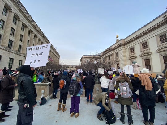 TRENTON -- Opponents of a bill to eliminate religious exemptions to childhood vaccines protest outside the Statehouse on Jan. 9, 2019.