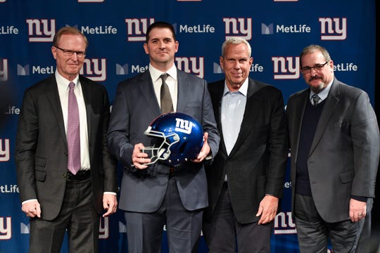 (from left) New York Giants CEO John Mara, new head coach Joe Judge, co-owner Steve Tisch, and general manager Dave Gettleman pose for photos at MetLife Stadium on Thursday, Jan. 9, 2020, in East Rutherford.