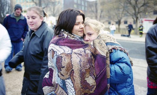 Seton Hall University students Vanessa Gomez of Maryland and Nicole Nocera of Old Bridge, N.J., wait outside the evacuated Boland Hall where a fatal fire broke out on January 19, 2000.