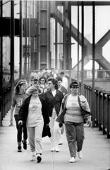 """""""Woggers"""" return from the second tower of the George Washington Bridge in their effort to raise money for the Leukemia Society during the second annual Wogging Day walk event in Fort Lee, N.J. October 2, 1988"""