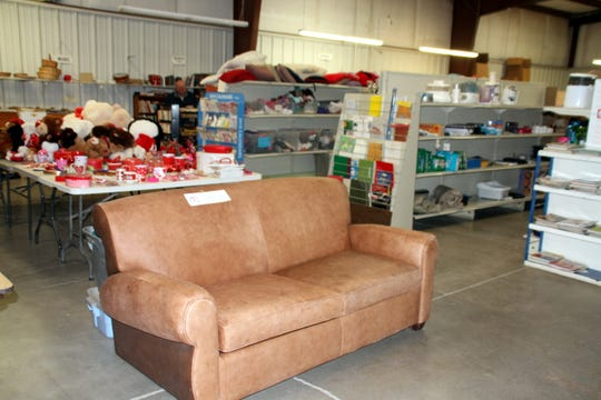 Gently-used furniture, household items, books, clothing, appliances, and footwear can be found at reasonable prices at the Helping Hand Thrift Store.