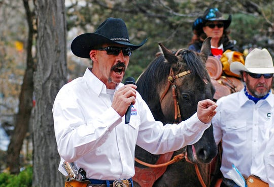 In this March 12, 2019, file photo, Cibola County Sheriff Tony Mace rallies protesters against gun control legislation at a gathering outside the New Mexico state Capitol in Santa Fe. Sheriffs across much of New Mexico are opposed to a legislative proposal from Democratic lawmakers to allow police or relatives to ask a court to temporarily take away guns from people who might harm themselves or others.