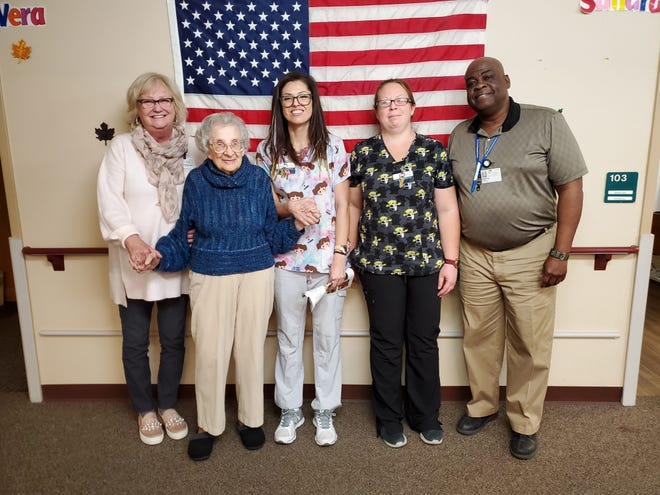 Elvira Berninger, pictured second from the left stands with staff of Good Samaritan Society.