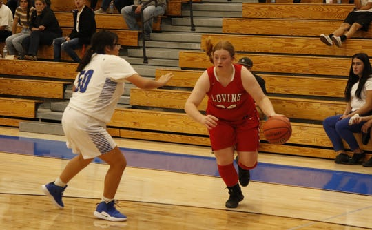 Loving's Mattie Cooksey drives the lane against the Carlsbad JV on Nov. 25, 2019. Cooksey is averaging 9.5 points and 12.8 rebounds a game for the Lady Falcons through 11 games.