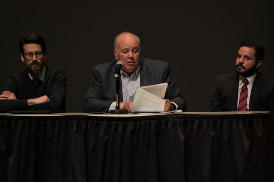 Farmington City Manager Rob Mayes, center, reads from a Los Alamos National Laboratory report about a carbon capture proposal for San Juan Generating Station, Wednesday, Jan. 8, 2020, during the Northwest Regional Economic Outlook Forum at San Juan College.