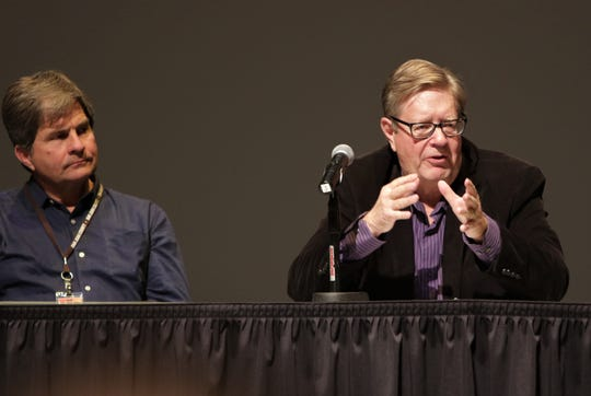 Bloomfield City Councilor Ken Hare, right, discusses the city's recent economic development efforts, Wednesday, Jan. 8, 2020, during the Northwest Regional Economic Outlook Forum at San Juan College in Farmington.