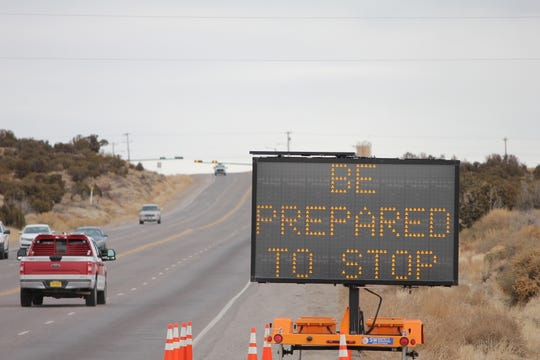 A sign warns drivers about a change to the traffic signal on County Road 350. Starting Jan. 13, the light will stop traffic rather than flashing red or yellow.