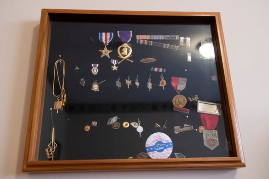 David Houck's Silver Star and Purple Heart (top) are displayed inside a case along with other parts of his uniform from his time in the service.