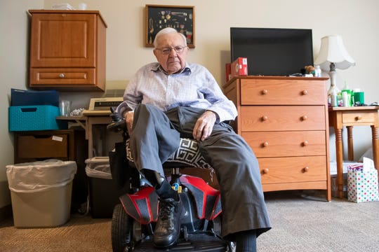 David Houck, 97, served as a lieutenant in the 745th Tank Battalion during World War II. He lost his right leg when a German mortar struck him during the Battle of the Bulge. He posed for this portrait inside his room at The Village at Utz Terrace on December 27, 2019.