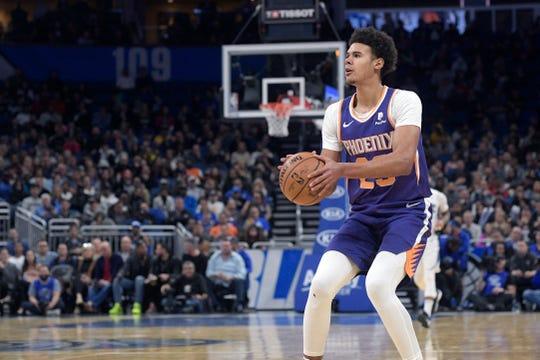 Phoenix Suns forward Cameron Johnson sets up for a shot during the second half of an NBA basketball game against the Orlando Magic Wednesday, Dec. 4, 2019, in Orlando, Fla. (AP Photo/Phelan M. Ebenhack)