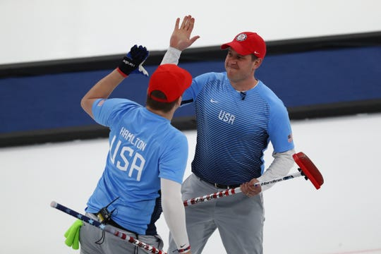 Matt Hamilton , left, and John Shuster celebrate during the gold medal men's curling match at the 2018 Winter Olympics. They are competing this weekend in Tempe.