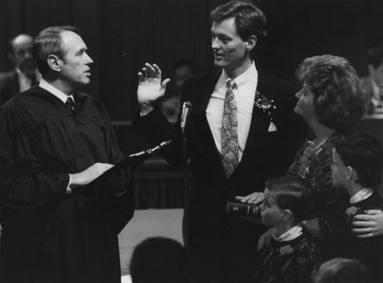 Paul Johnson is sworn in as Phoenix's 47th mayor by Arizona Chief Justice Frank Gordon Jr. Yvonne DeLisle, Johnson's mother, and his 2 sons look on in February 1990.