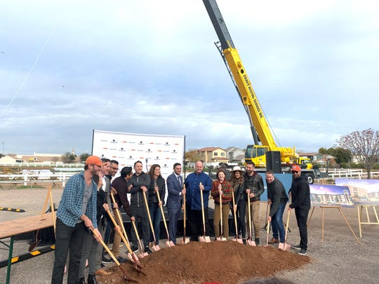 Individuals who have signed leases to live at Epicenter in Agritopia turn dirt at the groundbreaking on Jan. 9, 2020.