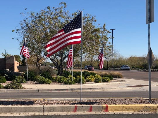 In a single day, as many as 200 American flags went up in Stratland Estates in Gilbert in honor of Dustin Harrison who was killed in a terrorist attack in Kenya.