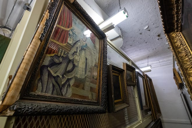 Paintings and other artwork hang on walls in the archives at the Port Huron Museum's Carnegie Center.