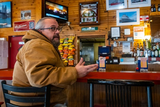 Russ Baatz, a resident of Harsens Island, sits at the rail at Sans Souci Bar Thursday, Jan. 9, 2020, on Harsens Island.