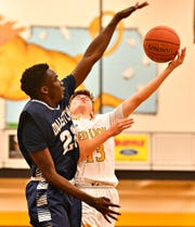 Dallastown's Leke Ogunnupe, left, defends as Red Lion's Evan Watt takes the ball to the hoop during basketball action at Red Lion Area Senior High School in Red Lion, Wednesday, Jan. 8, 2020. Dawn J. Sagert photo