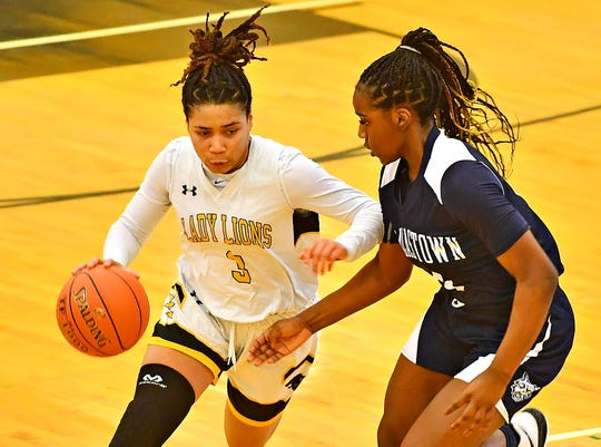 Red Lion's Asia Eames, left, moves the ball down the court while Dallastown's D'Shantae Edwards defends during basketball action at Red Lion Area Senior High School in Red Lion, Wednesday, Jan. 8, 2020. Red Lion would win the game 46-32. Dawn J. Sagert photo