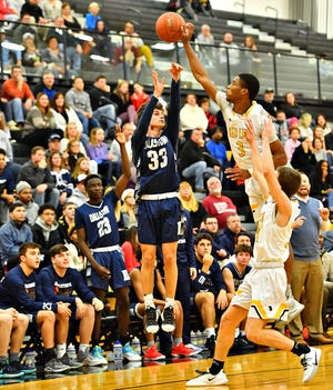 Red Lion's Davante Dennis, right, hits the ball from the air after Dallastown's Kane Bowers aims for the hoop during basketball action at Red Lion Area Senior High School in Red Lion, Wednesday, Jan. 8, 2020. Dallastown would win the game 45-40. Dawn J. Sagert photo