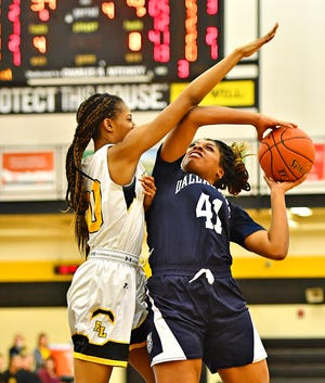 Dallastown's Bria Beverly, right, aims for the hoop while Red Lion's Makiah Shaw defends during basketball action at Red Lion Area Senior High School in Red Lion, Wednesday, Jan. 8, 2020. Red Lion would win the game 46-32. Dawn J. Sagert photo