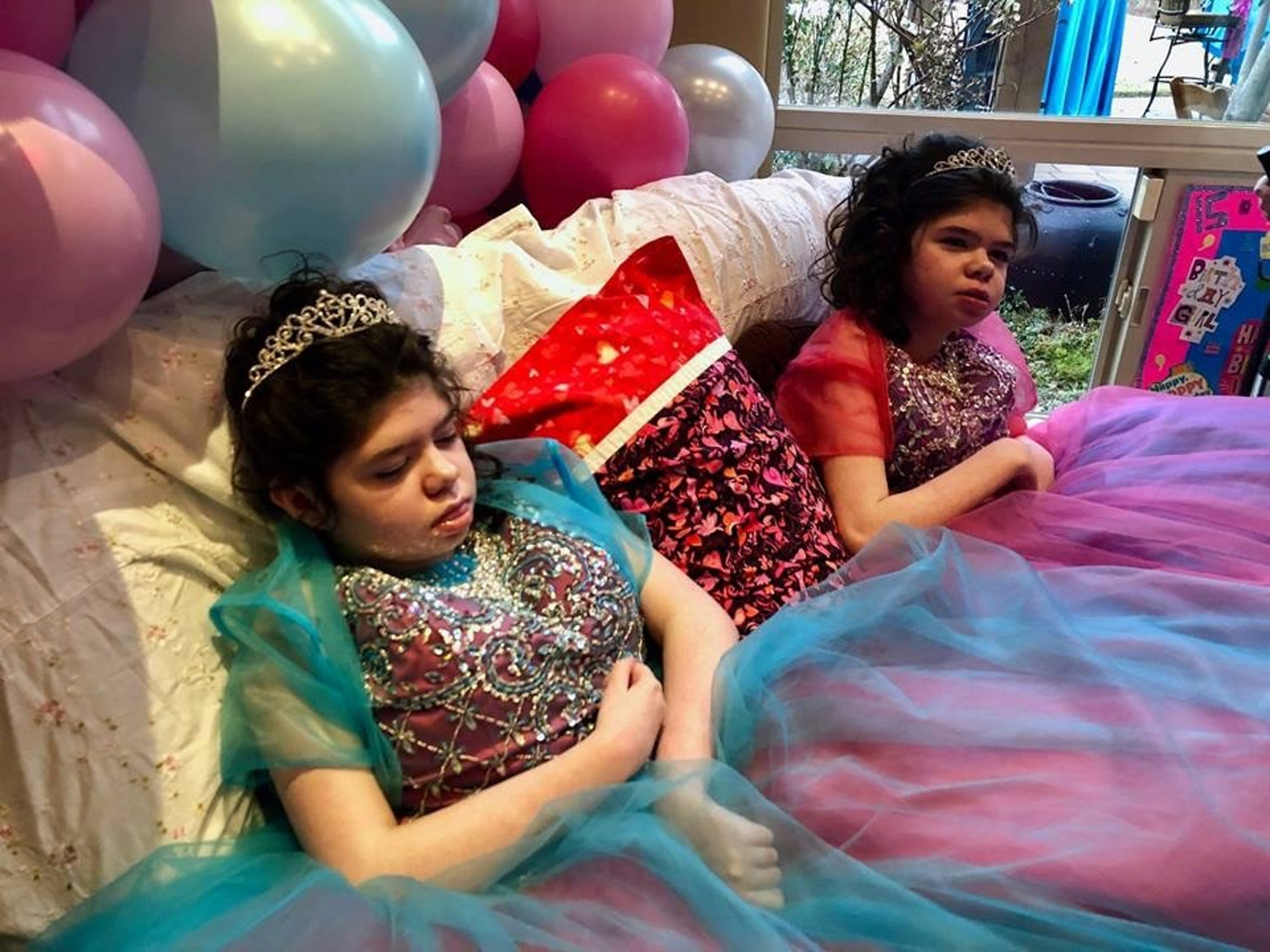 Addi and Cassi Hempel at their Quinceañera, a party to celebrate their 15th birthdays in January.  The girls, who battled a rare genetic disease died in July.