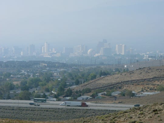 Dense smoke from the King Fire hangs over downtown Reno in 2014. The fire,  more than 100 miles away in California, triggered air quality alerts up and down the Sierra's eastern front for more than a week.