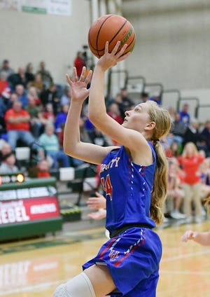 Union City's Skylie Lutz (14) drives for a layup during a 64-35 win against Randolph Southern on Nov. 16, 2019.
