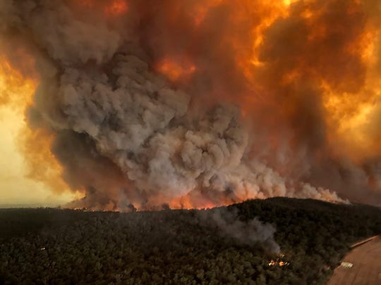 Wildfires rage under plumes of smoke in Bairnsdale, Australia, where North State firefighter Rick Noggles has been sent with a group of other federal firefighters. U.S. officials said Tuesday they planning to send at least 100 more firefighters to Australia to join 159 already there battling blazes that have killed multiple people and destroyed thousands of homes.