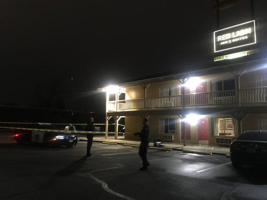 Redding police roll out crime scene tape outside of a hotel room on Wednesday, Jan. 8, 2020.