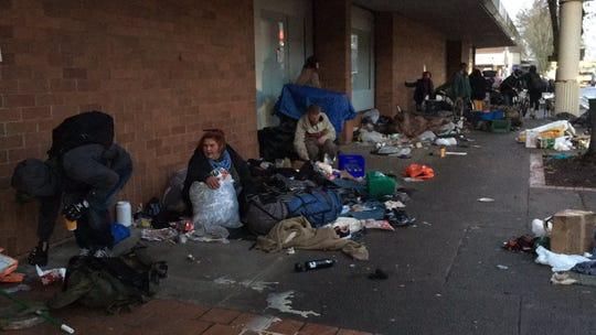 People gather their belongings on Center Street NE in downtown Salem Thursday, January 9.