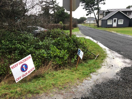 A sign expressing opposition to a plan by Facebook to build a landing spot for a submarine cable connecting America with Asia stands on property in the tiny community of Tierra del Mar, Ore., Wednesday, Jan. 8, 2020.