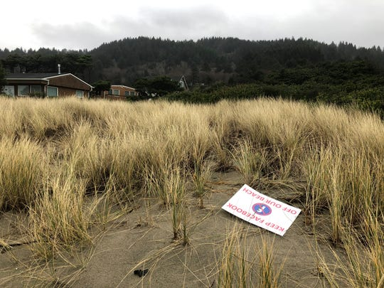 A sign denouncing Facebook's plans to put a landing site for a trans-Pacific fiber optic cable lies, Wednesday, Jan. 8, 2020, on the beachside property that a Facebook subsidiary bought in Tierra del Mar, Ore.