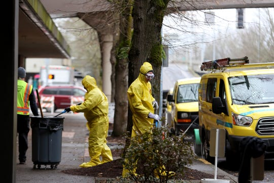 A ServiceMaster Clean crew starts to sanitize the sidewalk outside the former Nordstrom in downtown Salem on Jan. 9, 2020. People experiencing homelessness have been staying outside the former Nordstrom and the Rite Aid downtown for about two weeks.