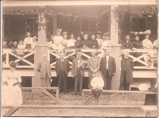 In this picture from 1900, a group poses in front of what was then named ÒHome for the HomelessÓ on Logan Street. The Glen was founded in 1898 and has evolved throughout the last century into what it is today.