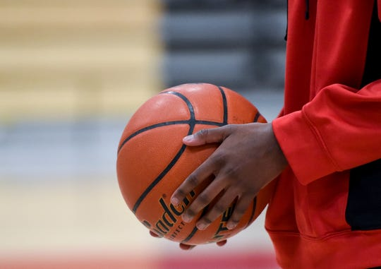"""Mhiretab Tsegaye, 16, shoots hoops during his first week back at school after recovering from a tragic car accident on Thursday, Jan. 9, 2020 at Lincoln High School. Tsegaye says he looks forward to playing basketball after his recovery. """"I'm getting better faster and faster,"""" Tsegaye said."""