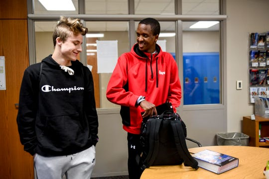 London Kolb, 14, and Mhiretab Tsegaye, 16, prepare to head to basketball practice during Tsegaye's first week back at school after recovering from a tragic car accident on Thursday, Jan. 9, 2020 at Lincoln High School. Tsegaye has spent the week catching up with friends and catching up on school work.