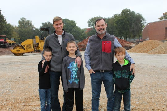Jason Carson, left, the CEO of Carson-Mitchell, with his sons Colin and Evan. Chris Carson, right, president and chief operating officer at Carson-Mitchell, with son Brandon.