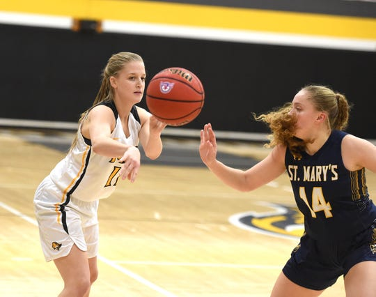 Mary Baldwin's Sara Moore passes the ball during  a non-conference game with St. Mary's Wednesday, Jan. 8 in Staunton.
