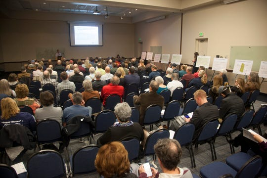 Members of the community gather for the Lake Powell Pipeline Project Public Scoping Meeting at the Dixie Convention Center Wednesday, Jan. 8, 2020.
