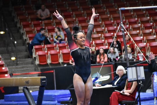 SUU's Karley McClain sticks the landing after her performance on the balance beam