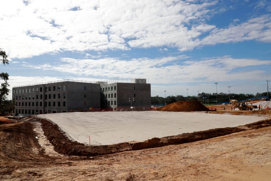 The north tower of the new residence hall on the FAMU campus will be open for the fall 2020 semester. The large area of cleared land will be a dining hall for residents.