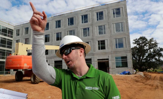 Tom Anguish, project manager with Finfrock, gives a tour of the construction site where new residence halls are being built on the FAMU campus. The building is one of two that will house up to 700 students.