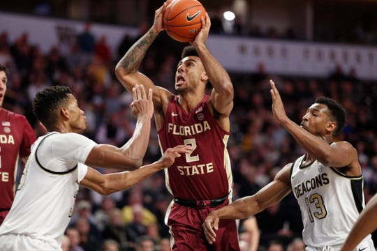 Florida State guard Anthony Polite (2) shoots between Wake Forest defenders in the second half of an NCAA college basketball game Wednesday, Jan. 8, 2020 in Winston-Salem, N.C. Florida State wins 78-68. (AP Photo/Lynn Hey)