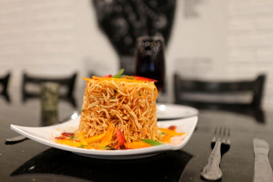 Chinese Bhel, a popular dish, a fast food item Northeast Indian origin, made of mixed fried noodles with shredded veggies and Aaru's special dressing.