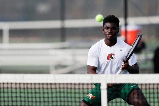 FAMU men's tennis player Robert Hayden plays two doubles with his partner Elliott Ekindi against the University of Louisiana Lafayette on Thursday, Jan. 9, 2020.