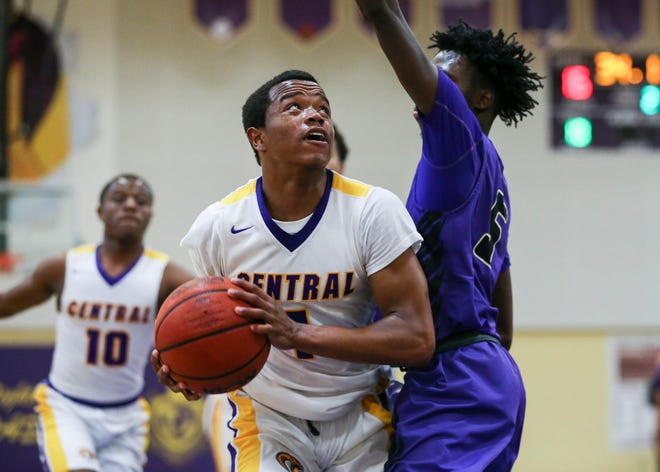Fort Pierce Central's Aaron Delince (1) charges the basket as Okeechobee's De'nitrik Whittaker (5) defends during the second period in a boys basketball game at Fort Pierce Central High School on Wednesday Jan. 8, 2020, in Fort Pierce.