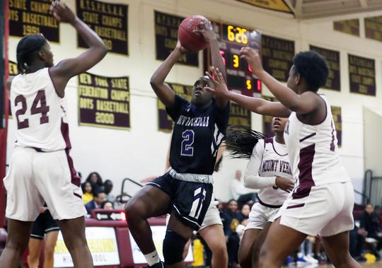New Rochelle Nia Bailey (2) drives to the basket against Mt. Vernon during  girls basketball action at Mt. Vernon High School Jan. 9, 2020. New Rochelle won the game 61-51.