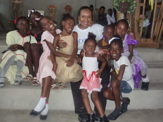 Jacqueline Cassagnol, center, with children during a trip to Haiti with her nonprofit, nonprofit, Worldwide Community First Responder, Inc., which offers disaster preparedness training.